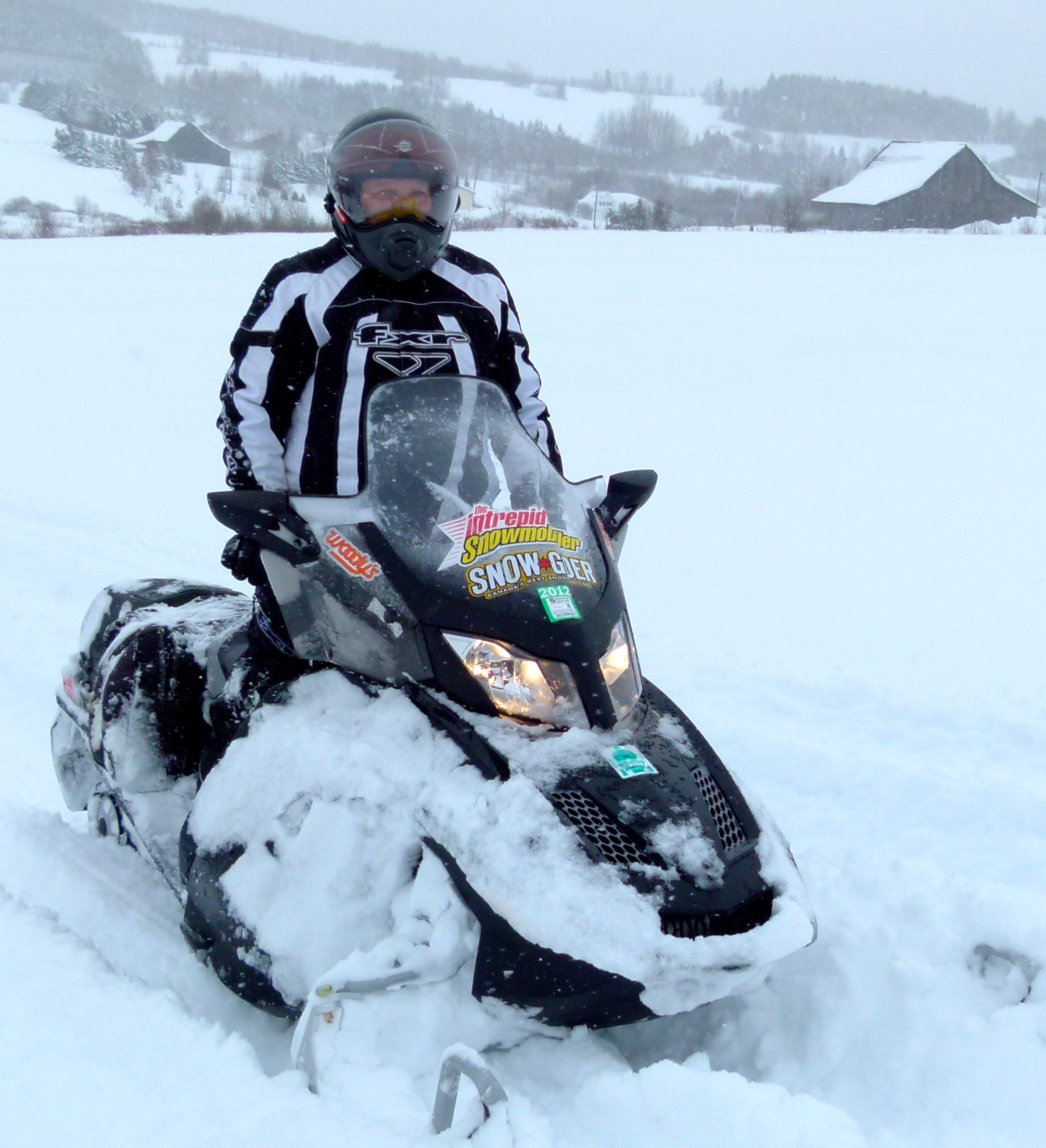 Women Snowmobiling in deep snow