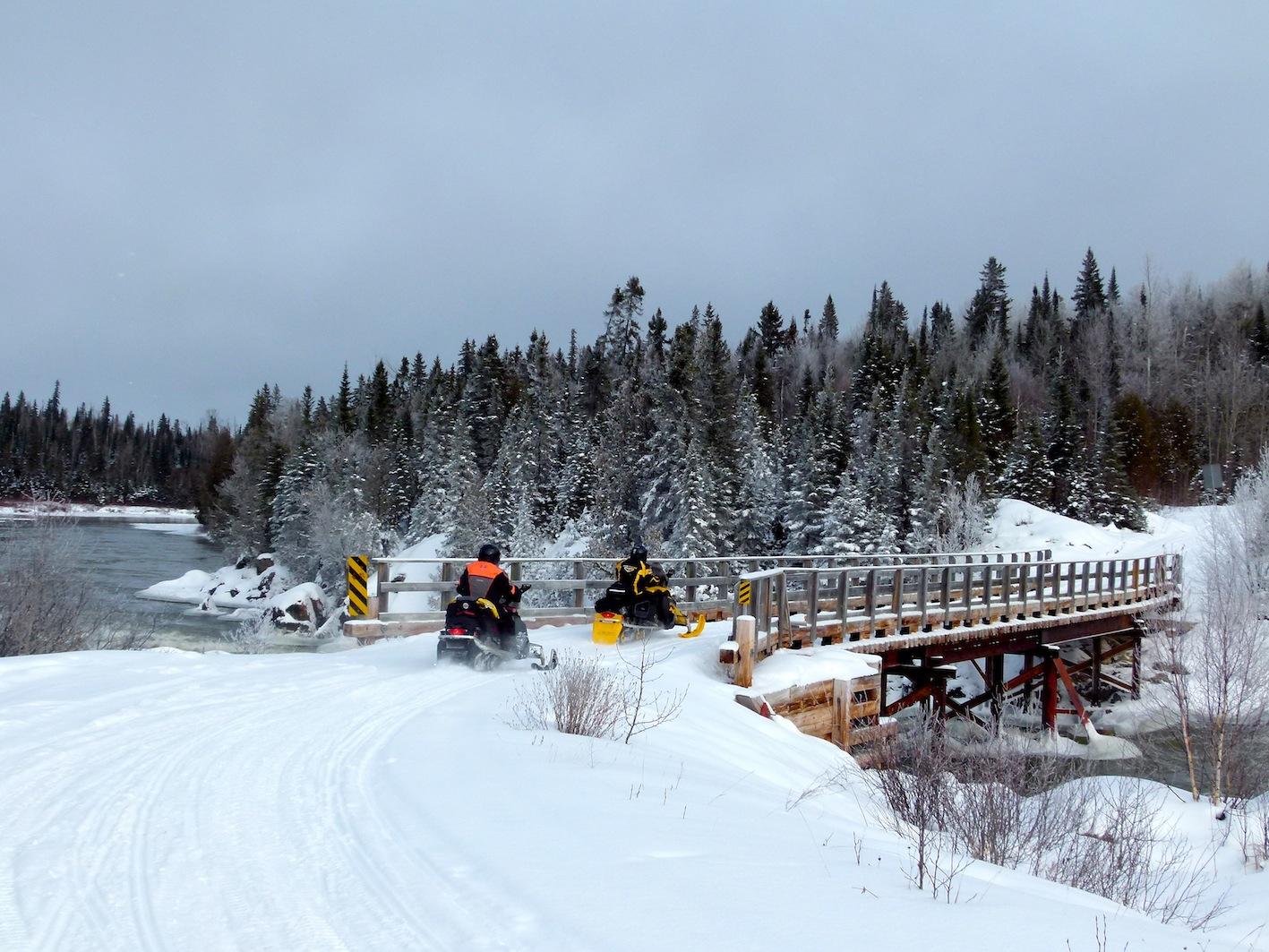 Northern Corridor snowmobiling Crossing the bridge on Trail L103 south of Cochrane