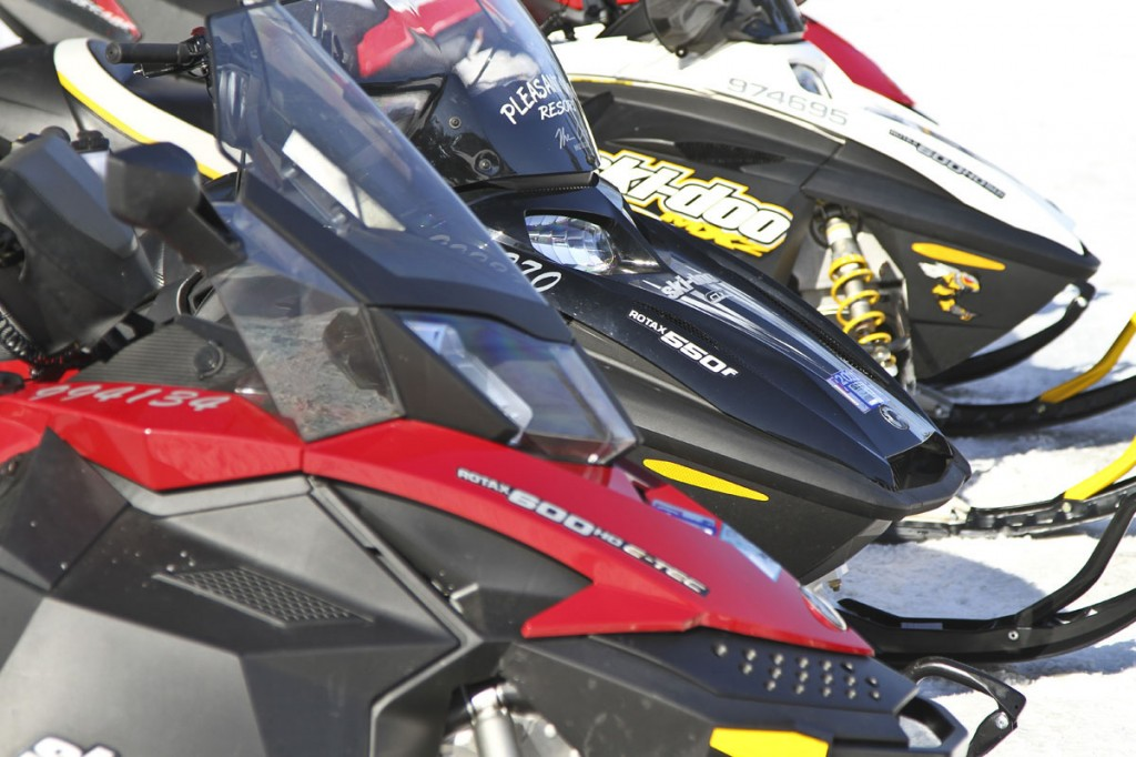 3 snowmobiles close up