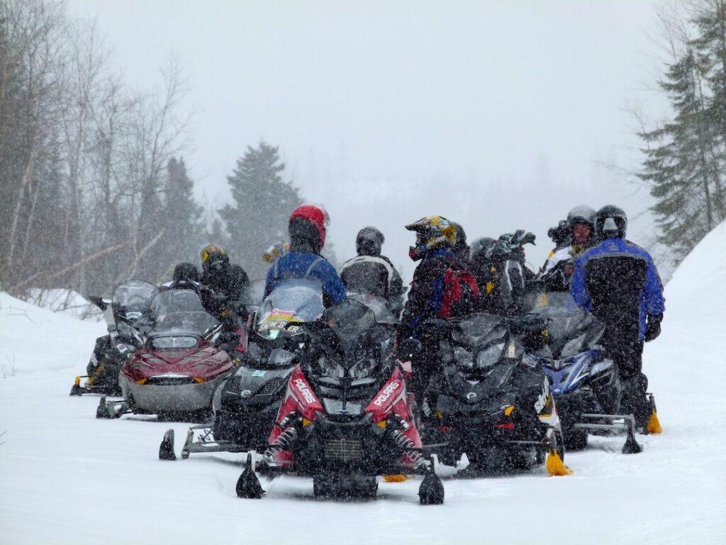 Start avoiding black snowmobile gear to get better photos