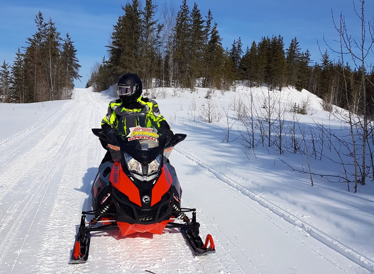 Rider in FXR snowmobile suit