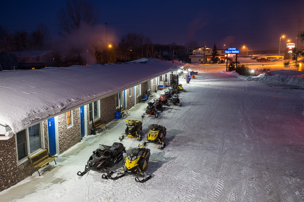 Overnight sled parking in front of ground floor rooms.