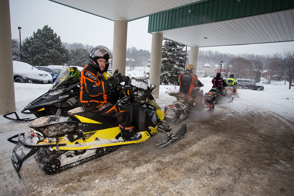 Leaving for a day ride from a good snowmobile staging hotel.