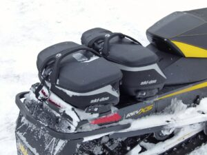 Ski Doo LinQ bags on the back of a snowmobile