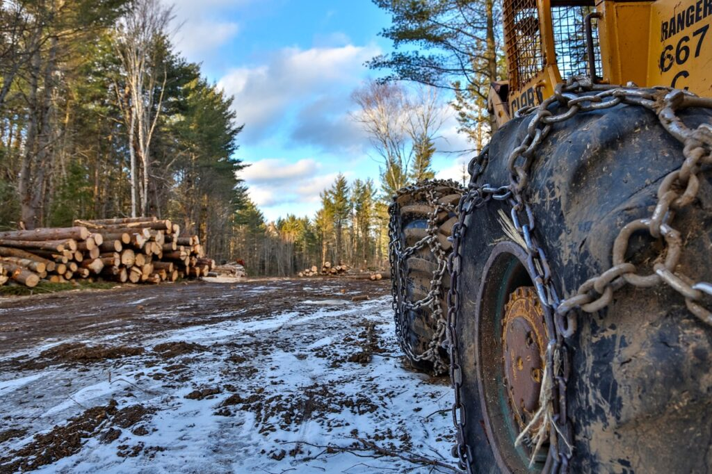 heavy equipment parked while snowmobiling active logging roads