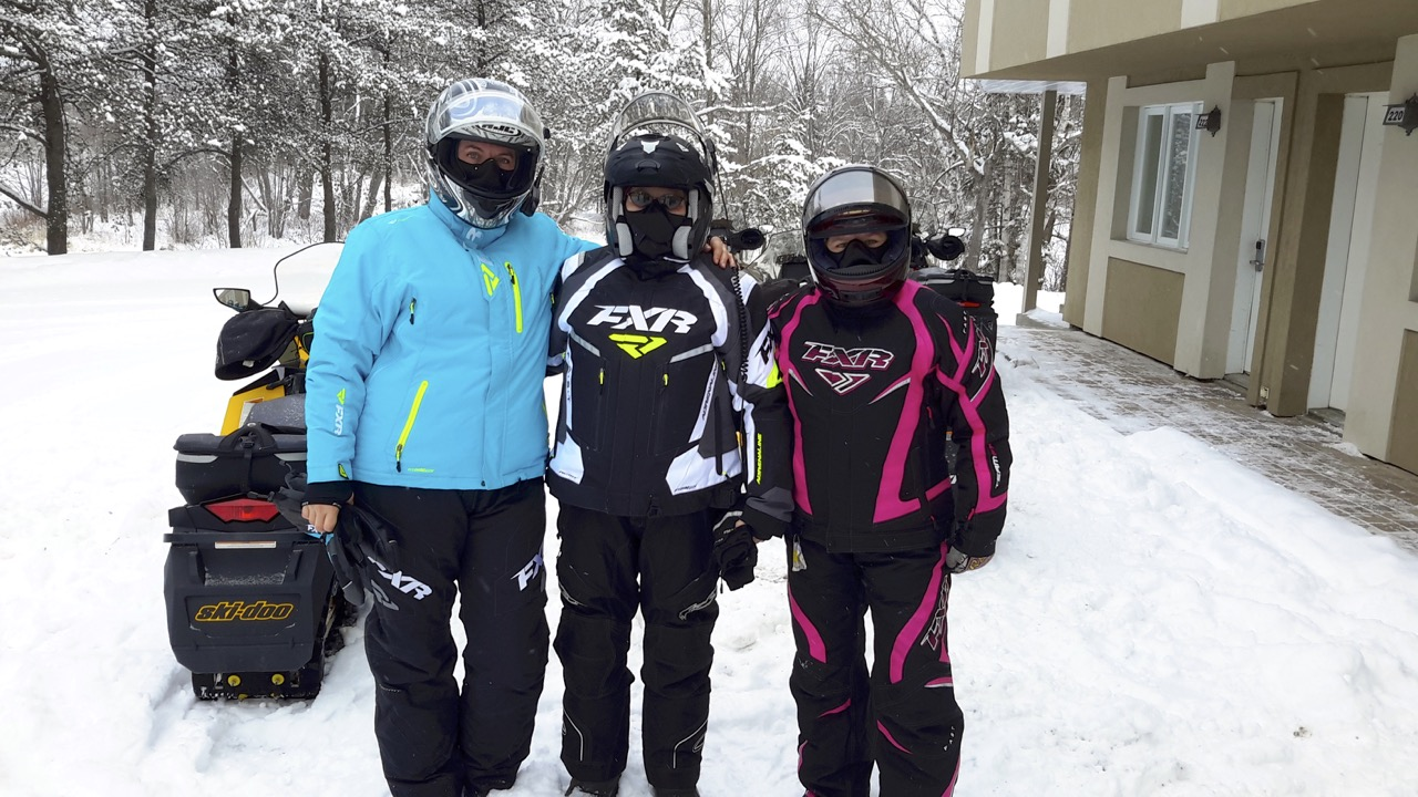 three women snowmobiling
