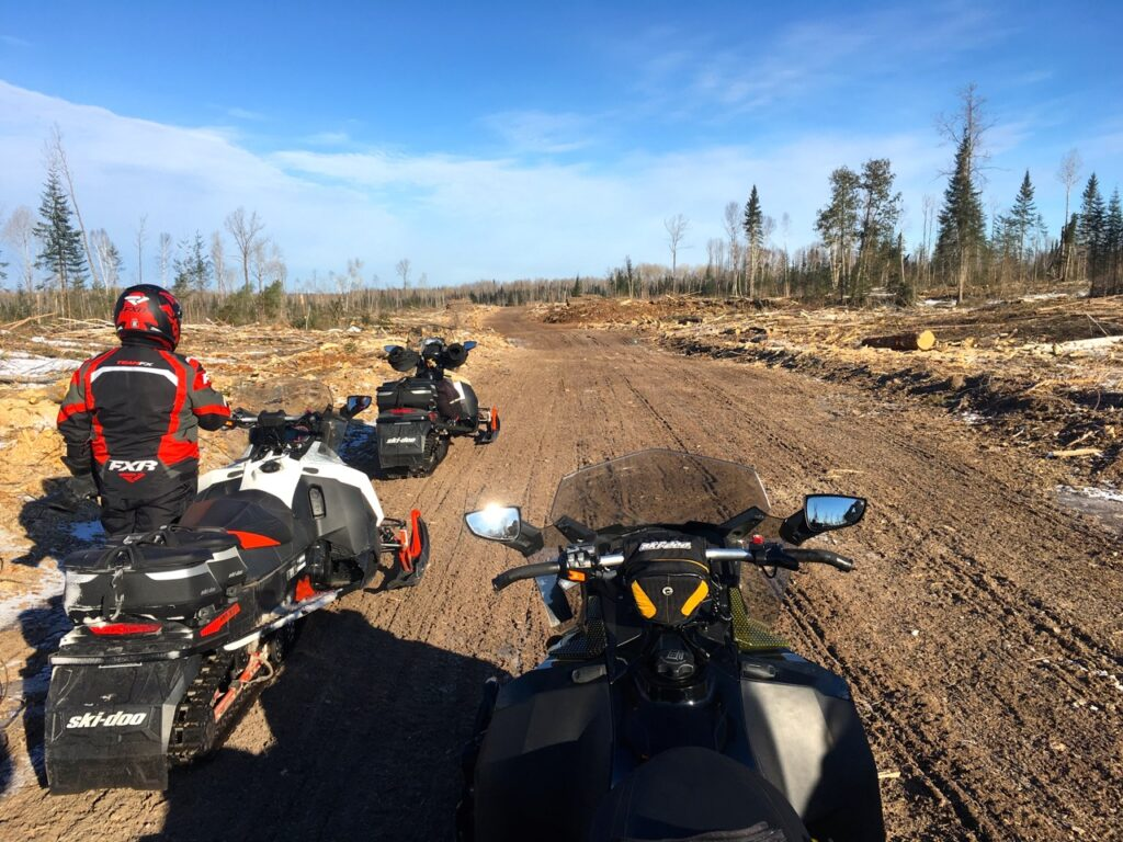 No snowmobiling active logging roads totally bare like this