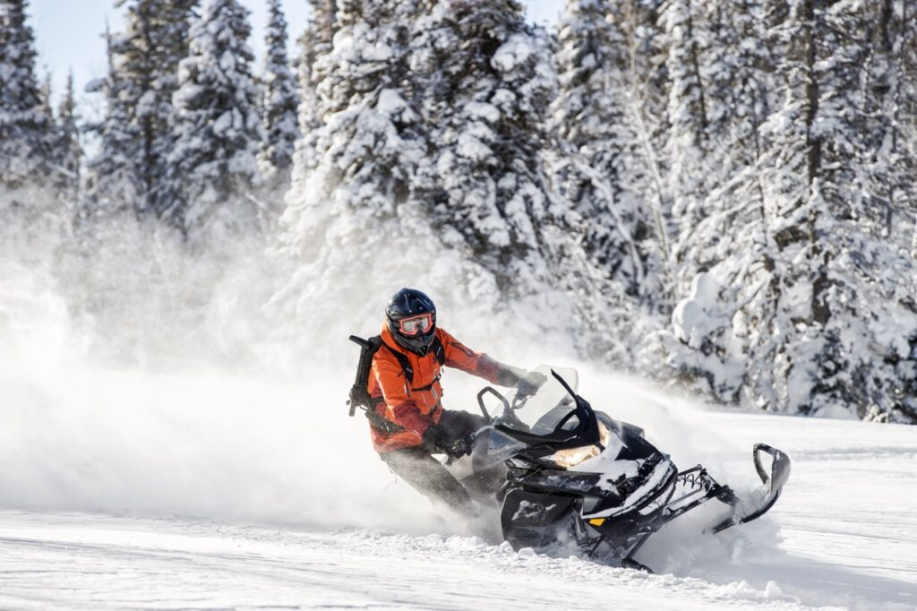 Deep powder snowmobile backcountry riding