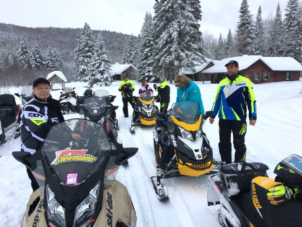 rest stop on couples snowmobile tour