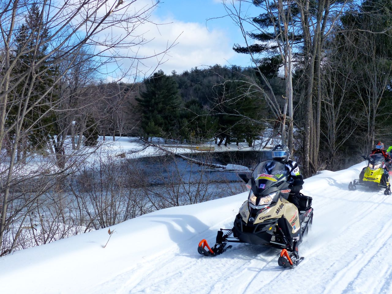 Riding beside York River while barry's bay ontario snowmobiling