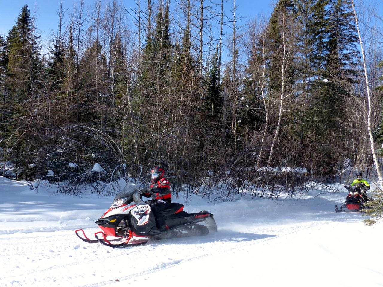 Riding ski doo sleds on OFSC snowmobile trail in barry's bay ontario snowmobiling