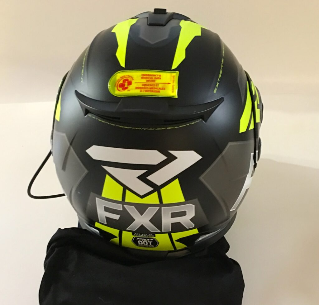 Medical data carrier affixed to back of FXR helmet