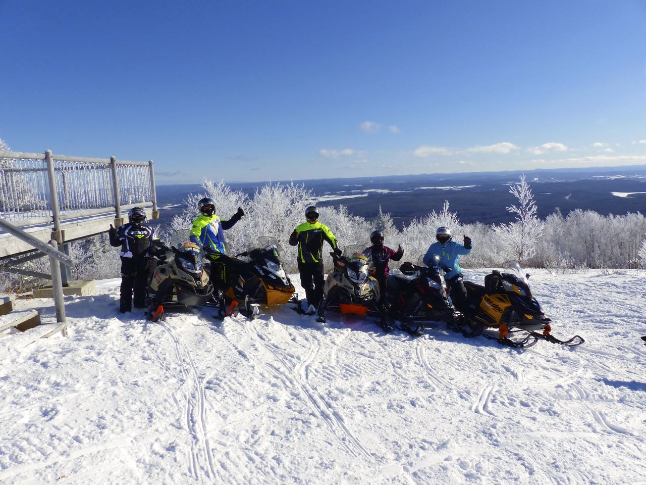 Ski doo sleds and FXR riders on Montagne du Diable in Laurentian Region of Quebec