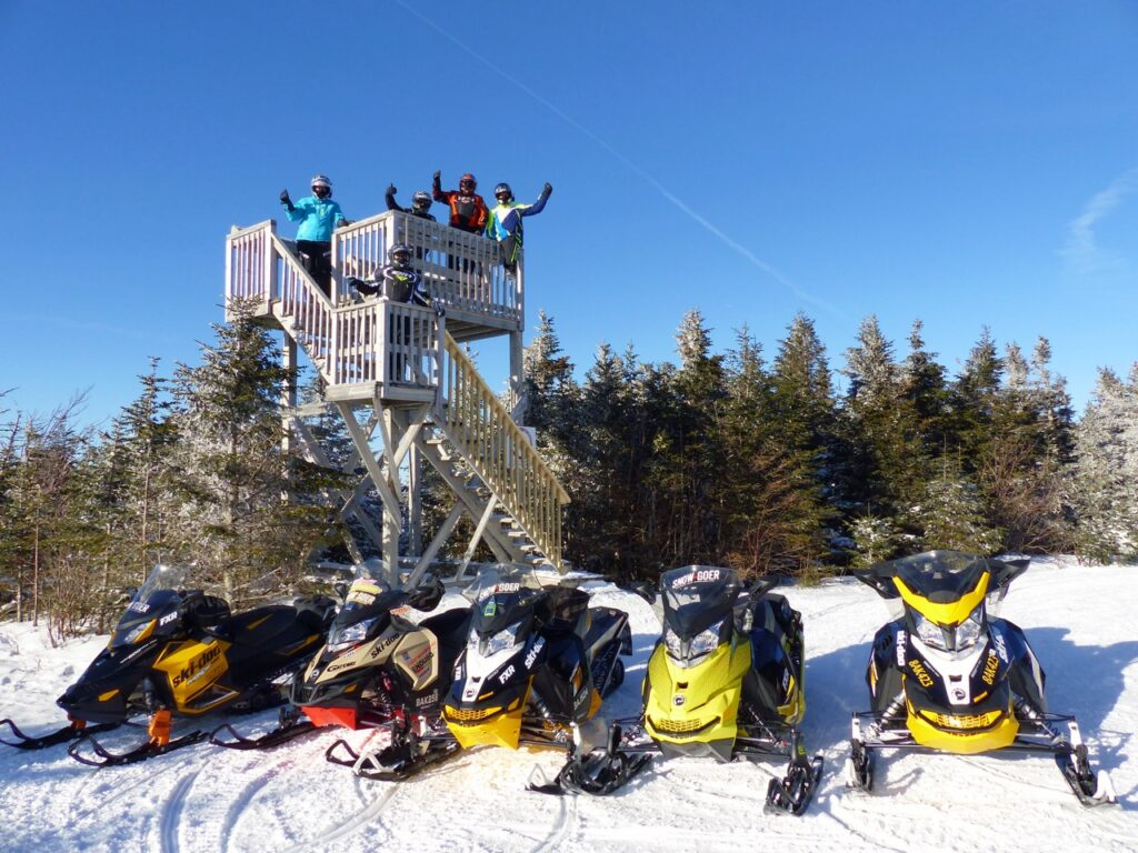 snowmobilers on lookout tower in Chaudière Appalaches Quebec