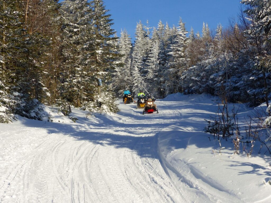 3 snowmobiles, groomed trail