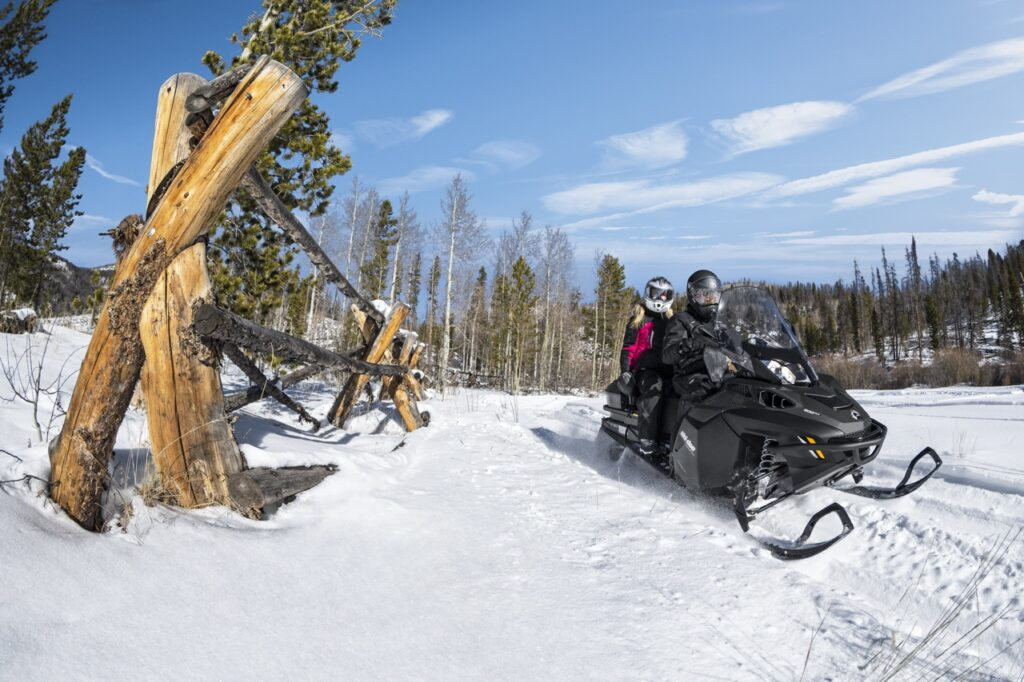 snowmobiling double near fence