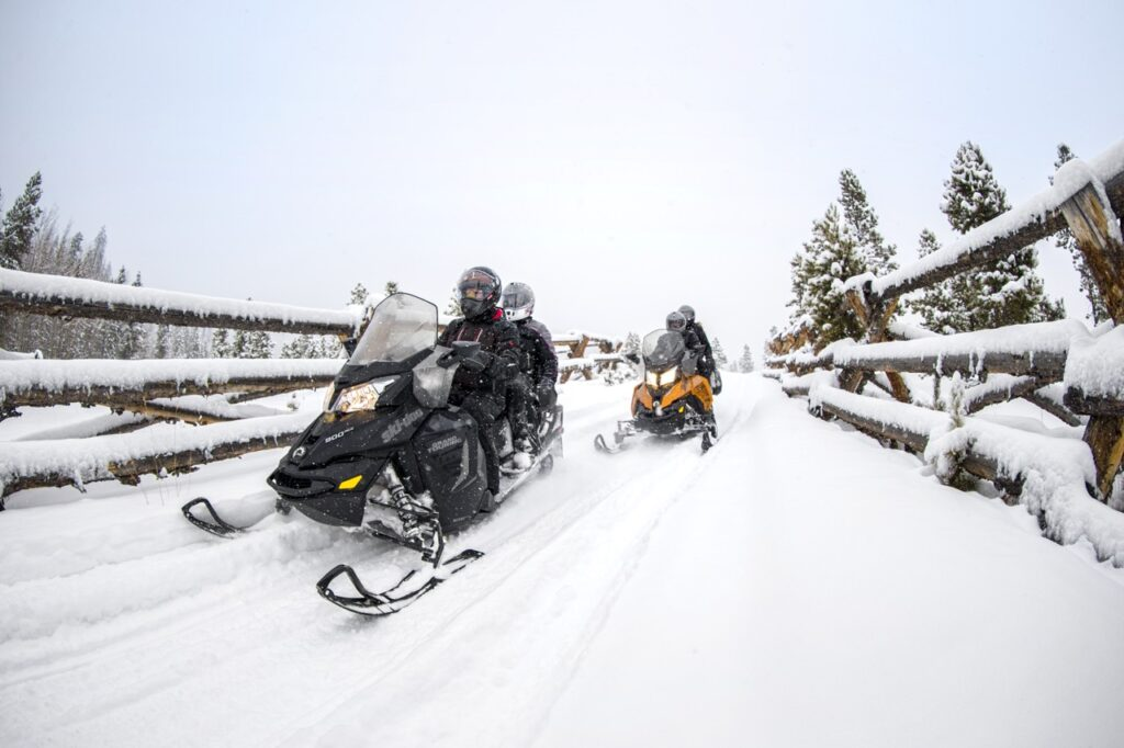 snowmobiling double between fence lines
