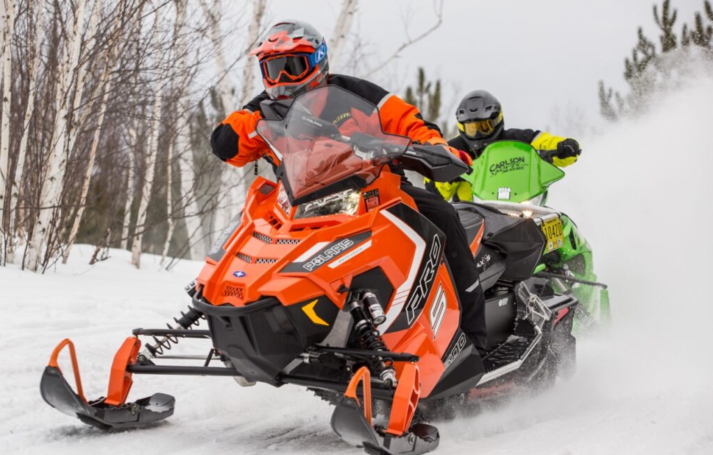 2 snowmobiles riding too close