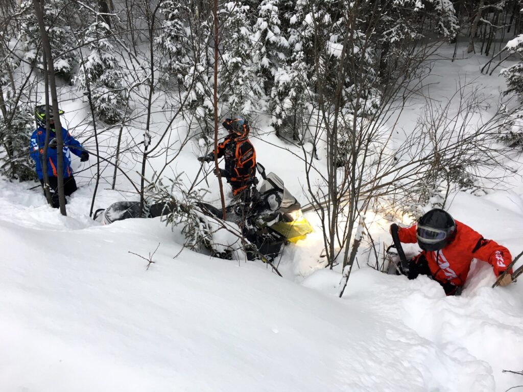 Diiging a snowmobile out of the rhubarb