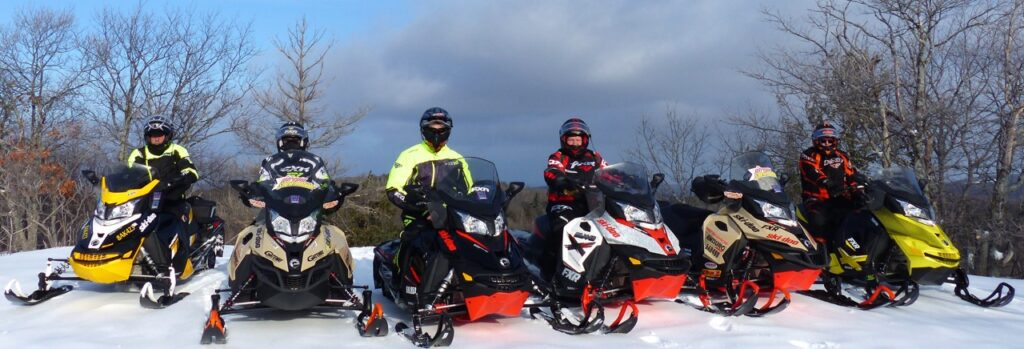6 sleds each with a different snowmobile windshield height