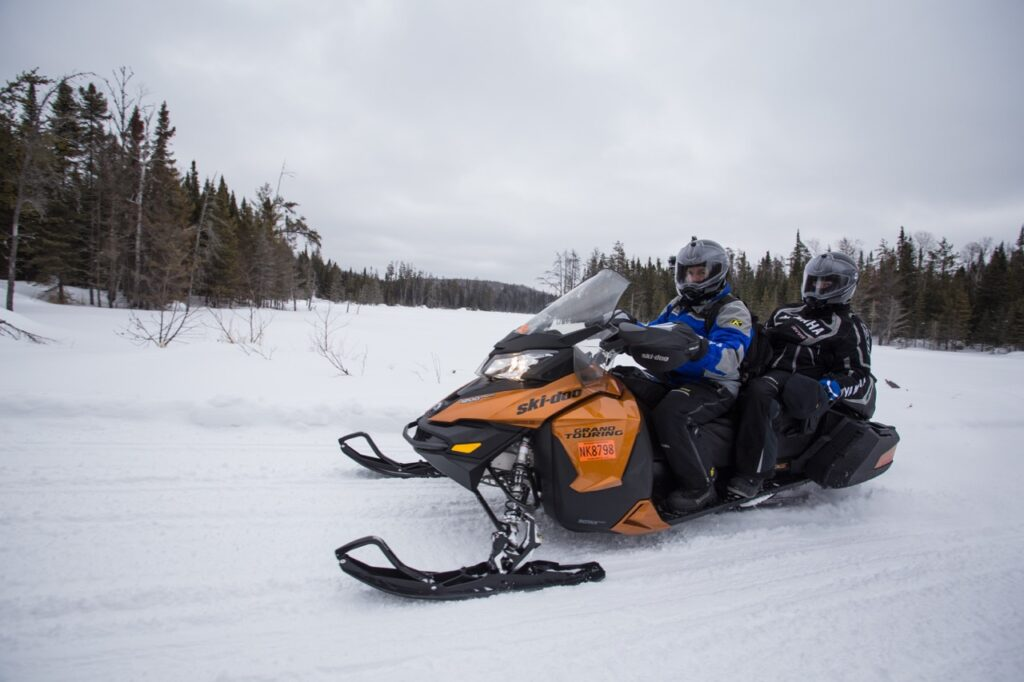 snowmobiling double with passenger