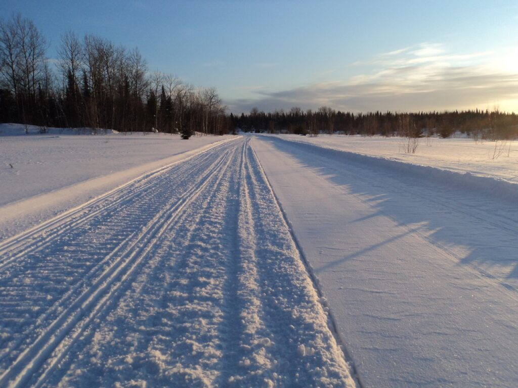 snowmobile trail groomed on right side