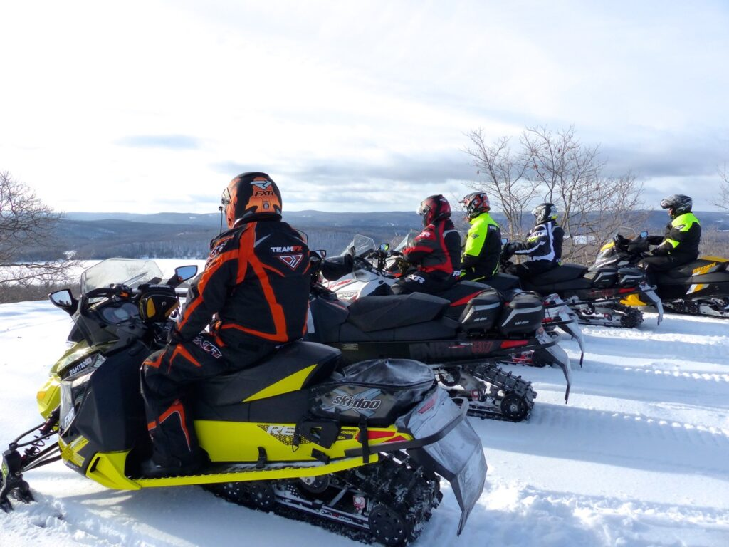 5 snow machines at Tom's Lookout in Madawaska Highlands