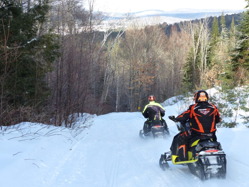 2 snowmobilers, hill country snowmobile trail