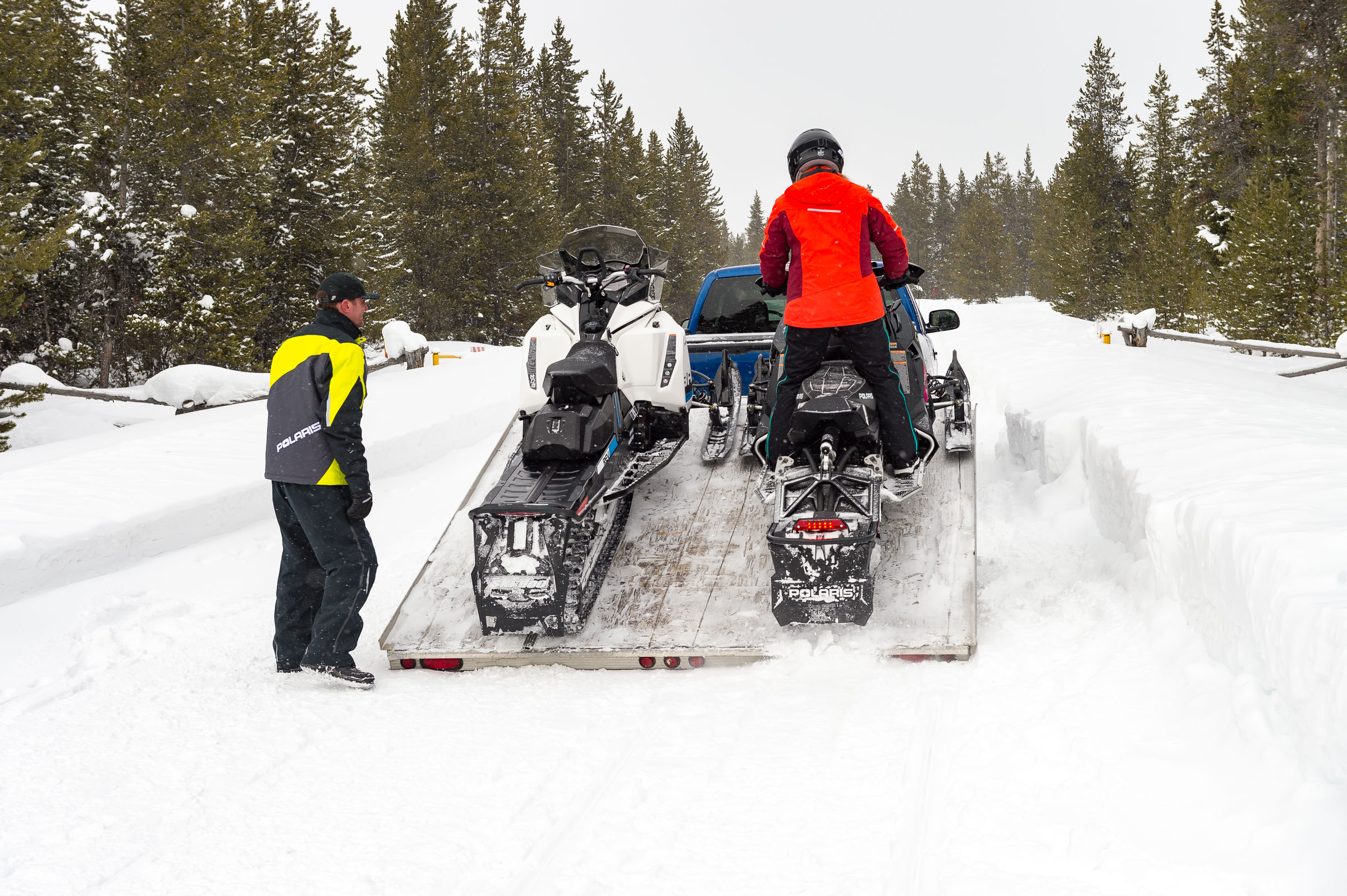 flatbed snowmobile trailers are open to the elements