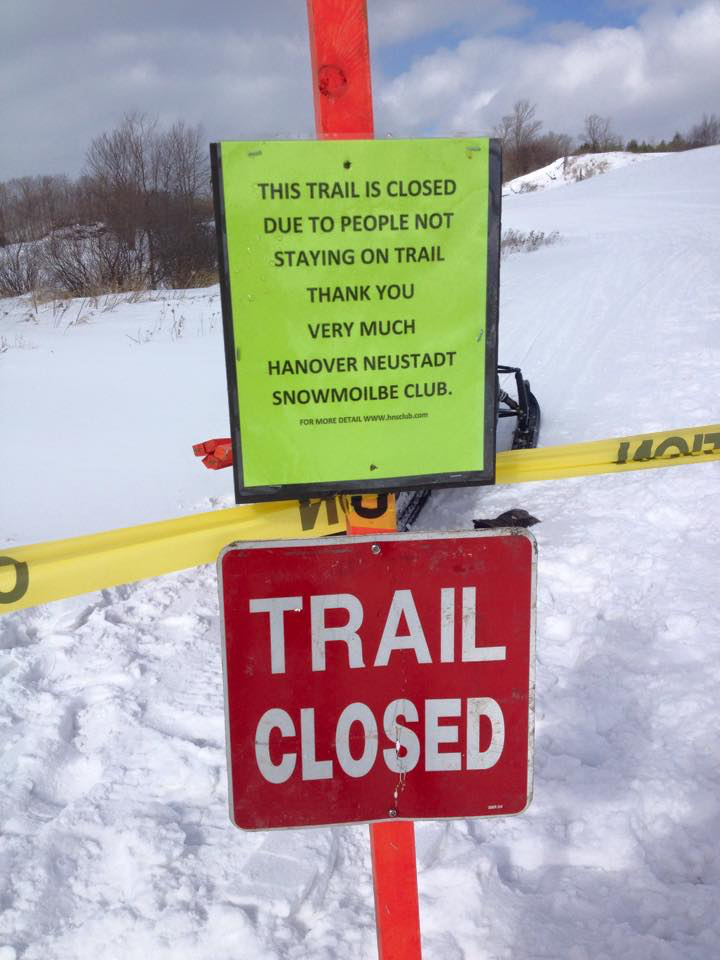 trail closed sign because riders did not stay on trail