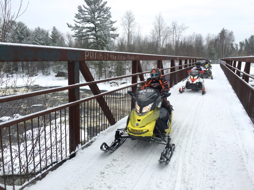 Crossing scenic bridge while Pembroke Ontario snowmobiling