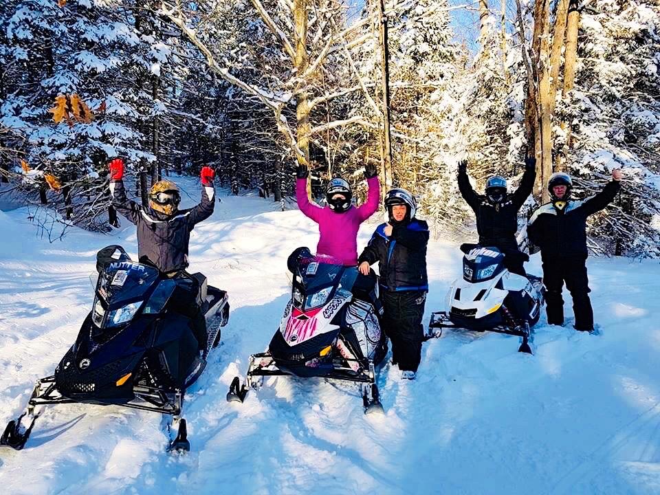 Snowmobiler celebrating best snowmobiling hubs near golden horseshoe