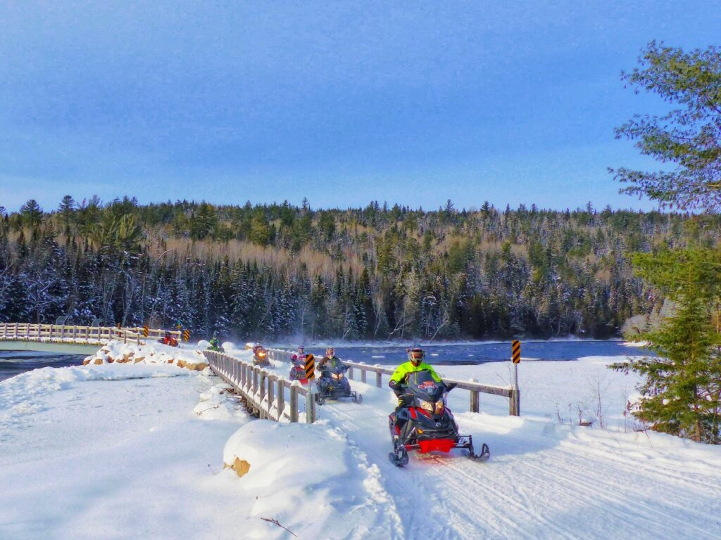 Great trails at early season snowmobiling destinations