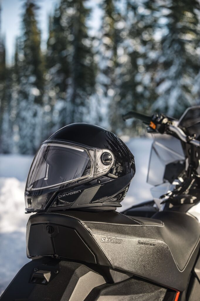 oxygen snowmobile helmet resting on snowmobile seat