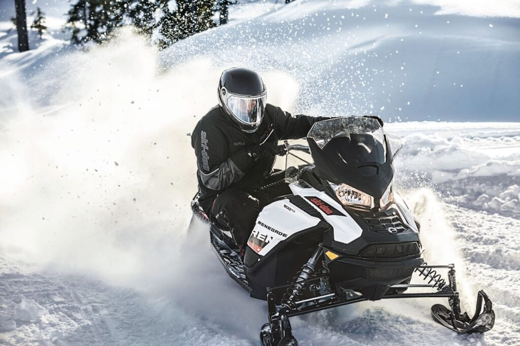 Solo snowmobiler riding with oxygen snowmobile helmet