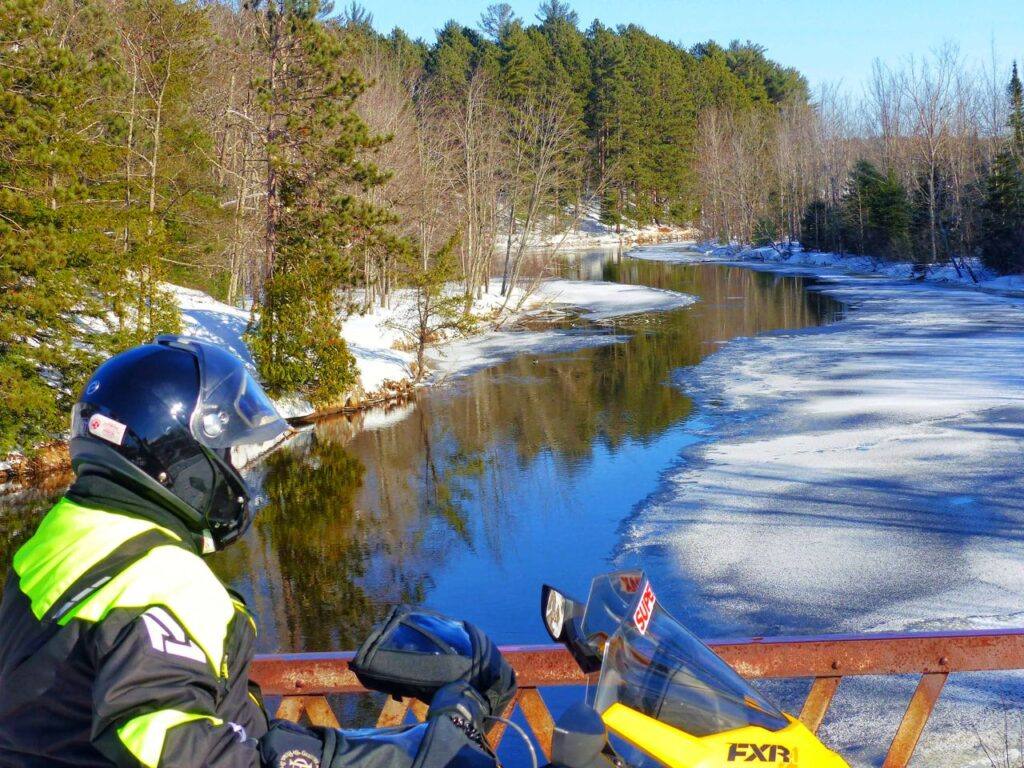 snowmobile Michigan Upper Peninsula sights include this beautiful river crossing