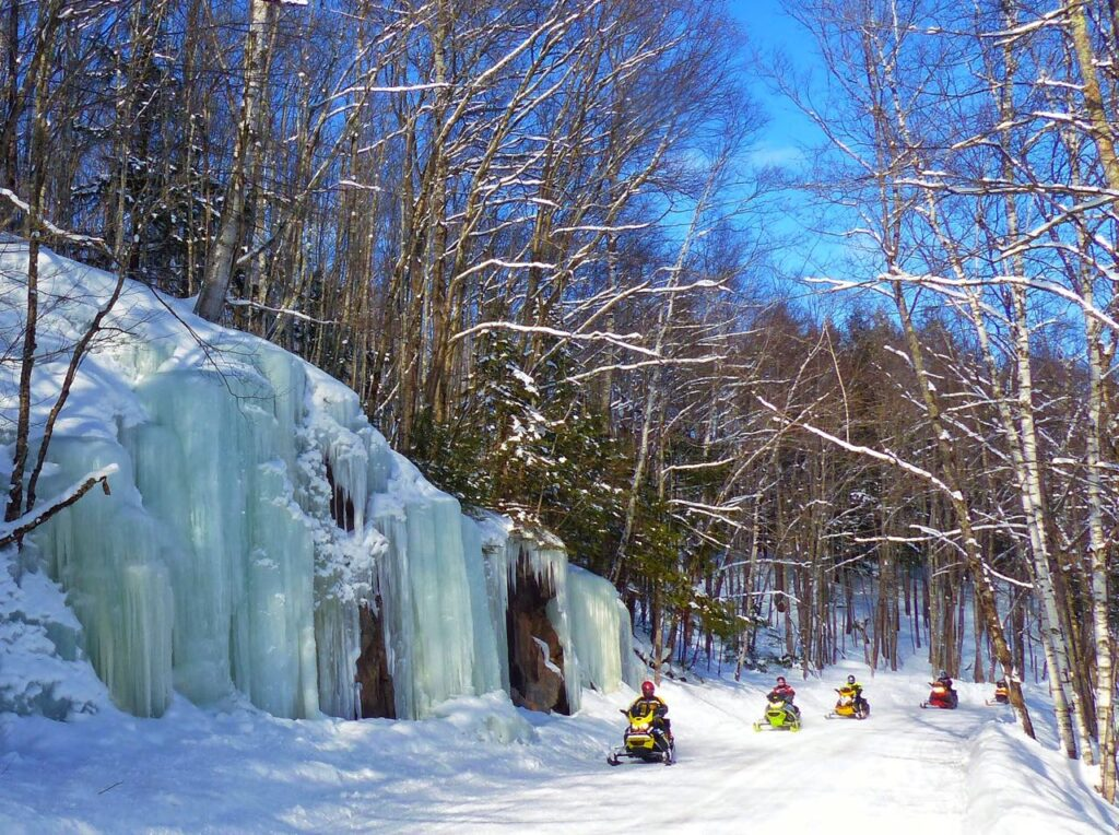 Snowmobile Michigan Upper Peninsula ice cliff beside trail