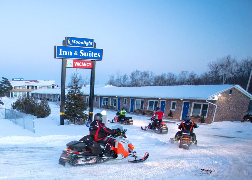 Sudbury Snowmobiling Snapshot shows snowmobilers arriving at Moonlight Inn & Suites