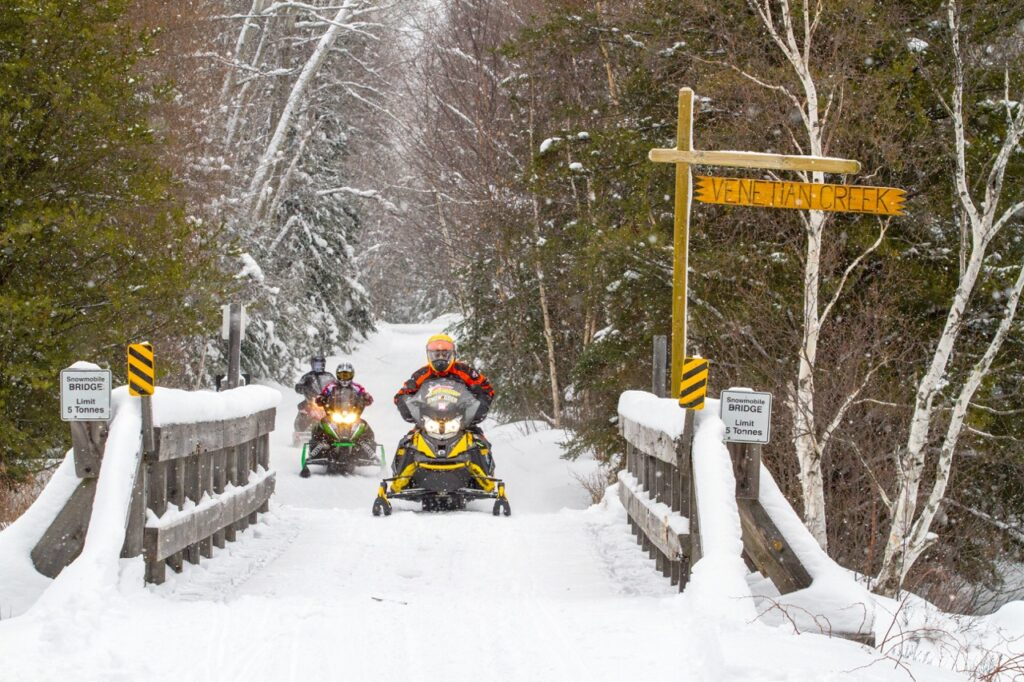 Sudbury Snowmobiling Snapshot shows sleds on Cartier Moose Loop trail