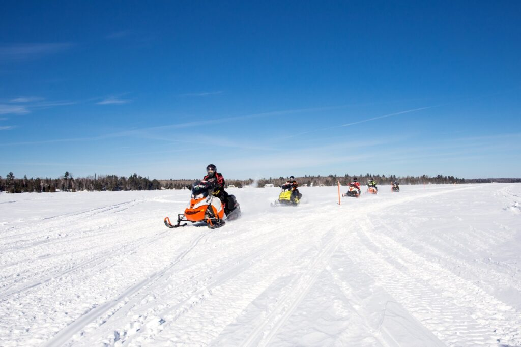 Sudbury Snowmobiling Snapshot shows sled crossing a lake