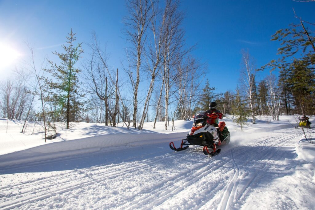 Sudbury Snowmobiling Snapshot shows two sleds on Sudbury trail