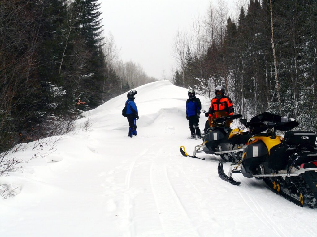snowstorm snowmobiling tips include dealing with drifts across trails