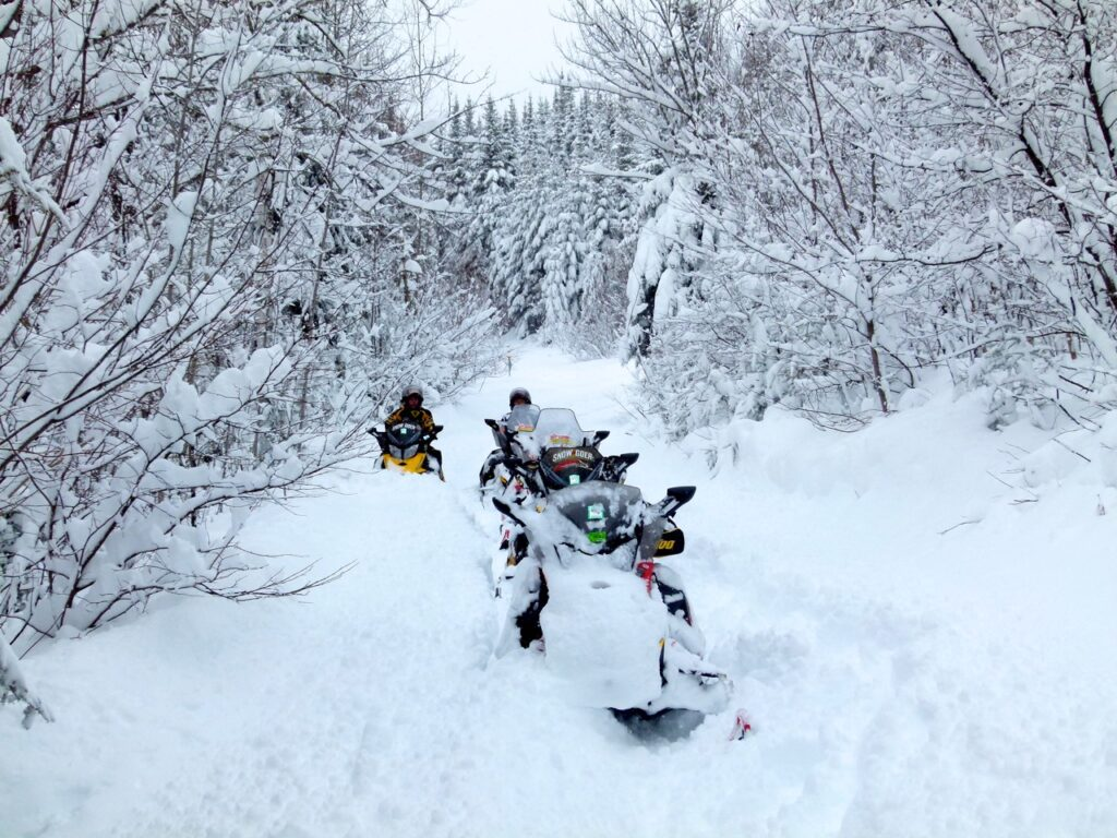 Snowstorm snowmobiling tips include avoiding closed trails.