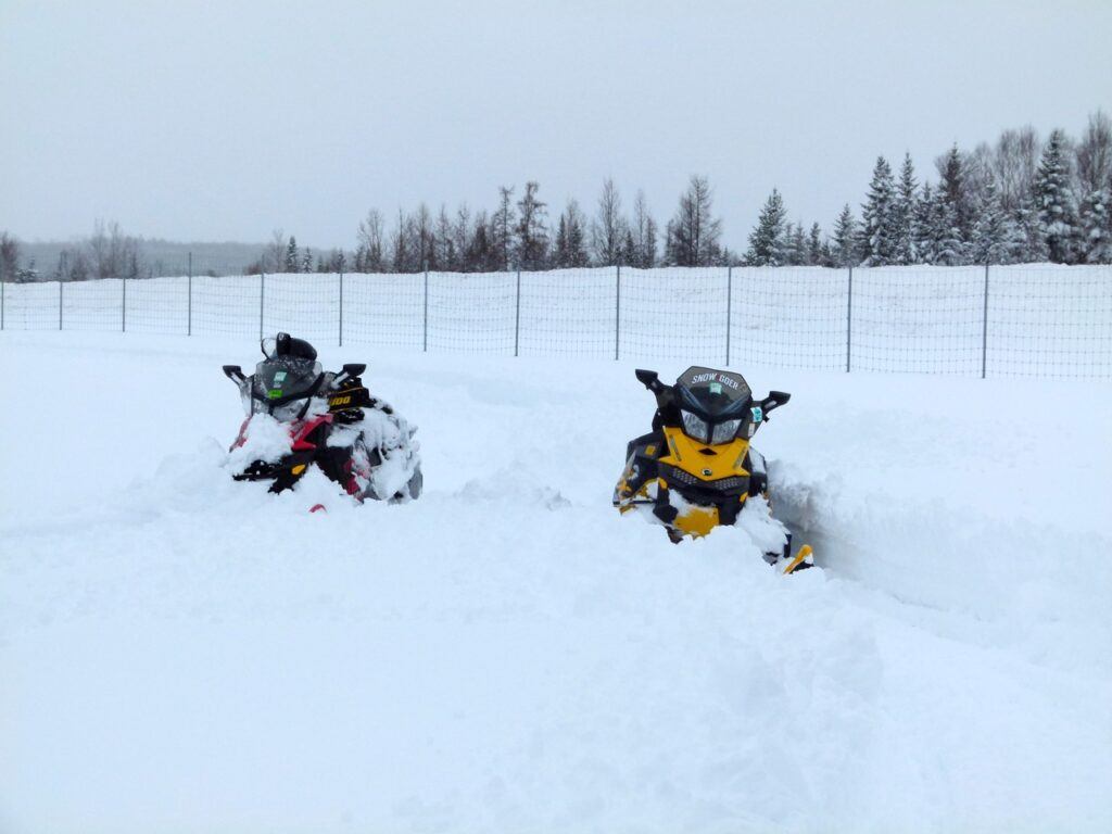 Snowstorm snowmobiling tips about navigating when deep snow covers the trail.