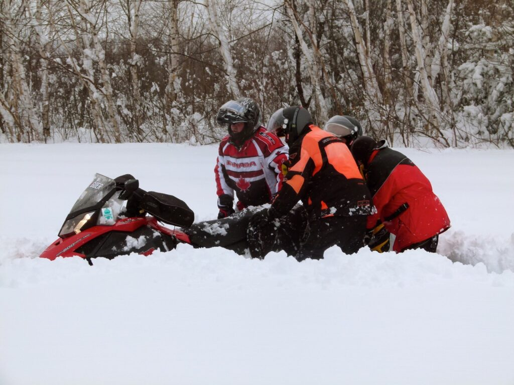 Snowstorm snowmobiling tips include getting stuck.