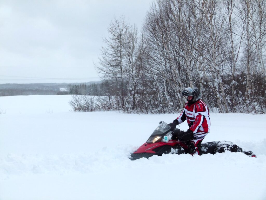 Riders making slow progress in deep snow is among snowstorm snowmobiling tips.