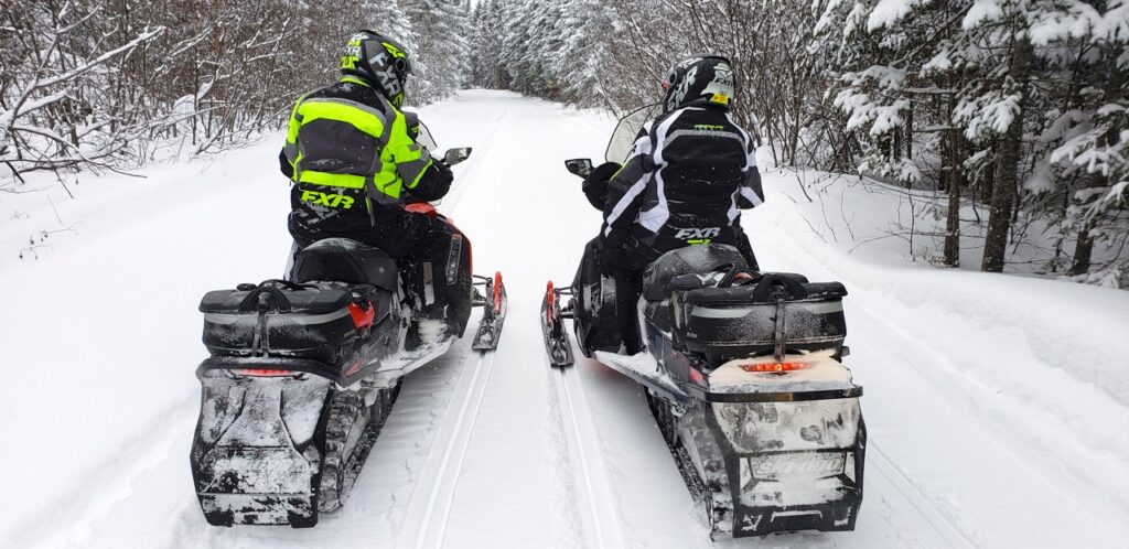 My wife Marsha & I piling on the snowmobile touring stats