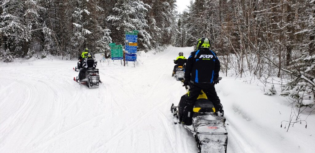 Snowmobile trail signs include town name signs