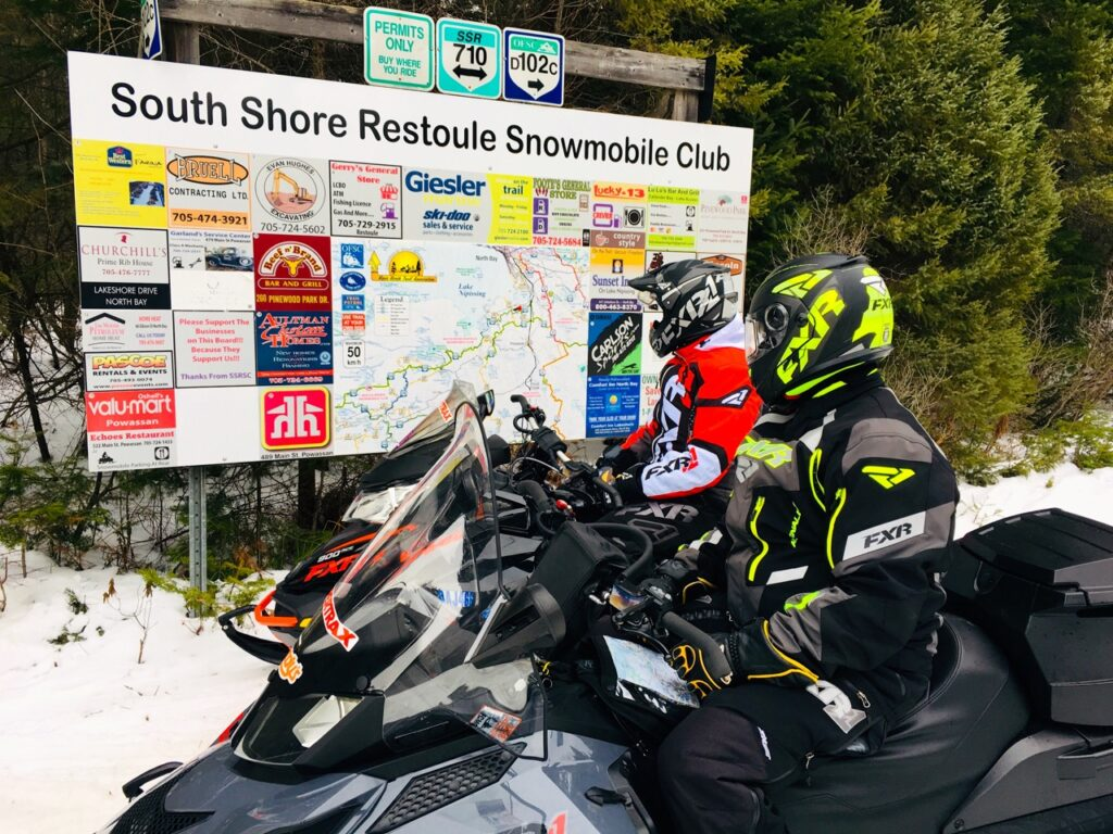 Snowmobile trail signs include good map boards at major intersections