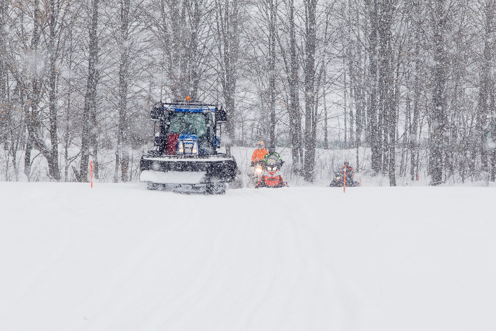 Passing a groomer to snowmobile Midwestern Ontario